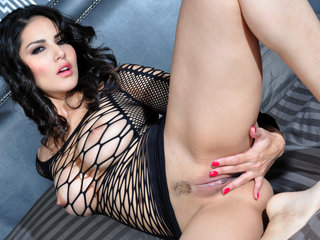 Beautiful Sunny Leone touches herself all over.